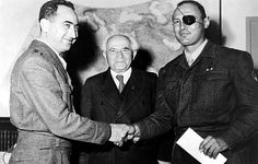 Israeli General Moshe Dayan (right) shakes hands with General Mordechai Marcleff. Prime Minister David Ben-Gurion looks on, 1960. Courtesy CSU Archives/Everett Collection