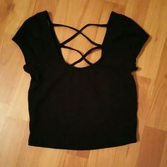 Black crop top Never worn , new but no tag.The front is the just low neckline, the back part have that crisscross thing. Very cute but too small for me. Forever 21 Tops Crop Tops
