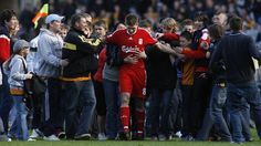 Liverpool captain Steven Gerrard swarmed by fans. Picture taken by Craig Brough, Action Images.