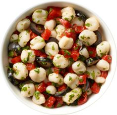 Simple Hominy Salad  A quick 5 minute dish!  1 (15 oz) can of Teasdale White Hominy, drained  1/3 cup pitted black olives  2 roasted red peppers, chopped  2 tablespoons lemon juice  1/2 cup cilantro, chopped  Salt to taste