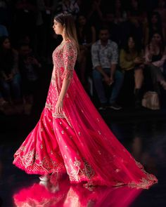 The 'Gulabi Noor' Trail ShararaAccommodating a broad selection of modern and jewel-tones like fuchsia pink, the trail sharara exudes an air of luxury and flamboyance. Playfully sinuous french-knots, splashed sequins, shimmering Moroccan motifs and traditional embroideries grace this marvelous ensemble. Sabyasachi, Lehenga, Heavy Dresses, Formal Dresses, Indian Dresses, Indian Outfits, Party Wear Dresses, Wedding Dresses, Indian Fashion