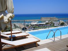 Housed in a listed 1920's building overlooking the Old Harbour of Heraklion, the prestigious 5-star hotel GDM Megaron offers fine dining, a health club and a rooftop plunge pool.