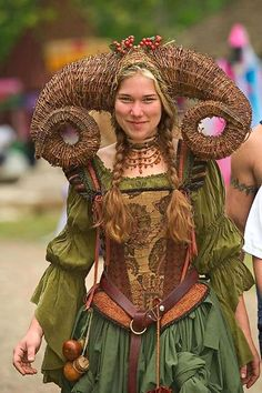 forget the dress, but I like that idea with the horns for a 12th theatric costume - we know from texts that they used masks and so far we thought of and made fealted ones, but wicker is another theoretical option.... just storing the idea here - no proof yet