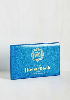 Buckle up for a fun-filled ride with this glittery blue guest book! Designed to transform traffic jams into jam sessions and errands into all-day excursions, this padded hardcover offers everything from car bingo and doodle space, to a roadside report card and driver citations. Sign, date, and sit back with this quirky keepsake to enjoy the ride!