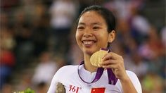 Gold medalist Zeng Sini of China poses on the podium during the victory ceremony for the women's Individual C1-2-3 Pursuit Cycling on Day 1 of the London 2012 Paralympic Games at the Velodrome