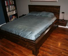 I decided I wanted a cool modern bed. So I made one, and this is how. But a couple of notes before we begin. 1. I apologize that all of the pictures in this Instructable (sans the finished ones) were taken with a mediocre phone camera. 2. I am not a master carpenter and pretty much only know what I learned from my dad and watching Bob Vila and Norm from New Yankee Workshop. With that in mind, if I can do this, you can probably do this, and better than I can. 3. I was looking for a...
