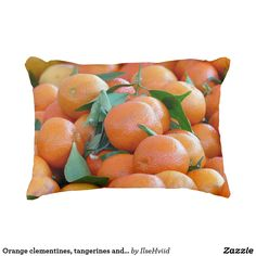 Orange clementines, tangerines and green leafs
