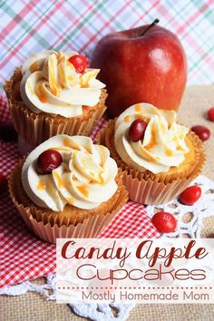 Candy Apple Cupcakes with Cinnamon Buttercream Frosting - Spiced cake mix cupcakes with apples in the batter and topped with cinnamon buttercream frosting, Candy Apple M&Ms, and a drizzle of caramel!