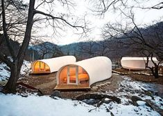 Glamping Architecture by ArchiWorkshop offers a unique camping experience. Two types of Glamping units with contemporary design positioned in the.