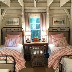matching twin beds with white linens and florals.