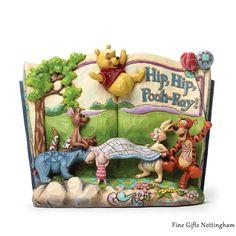 Disney Traditions Winnie The Pooh Storybook Figurine 'Hip Hip Pooh-ray' - Jim Shore 4046053 #WinnieThePoohStorybookFigurineHipHipPoohRay #DisneyTraditionsJimShore #FineGiftsNottingham