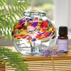 Lovely aromatherapy diffuser and lavender essential oil set. Swirled colors in this handblown art glass glow in sun or lamplight.