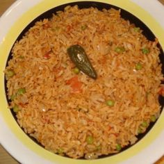 This rice dish has been passed down by my great grandmother from Mexico. It is an easy recipe to make. My family loves this rice and it can be served with almost any chicken or meat dish. Best when made with homemade broth but I find canned broth does fine. When presenting at the dinner table the jalapeno in the middle looks pretty. Enjoy
