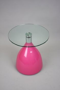 """19"""" Round Side Table - Pink Candy Drop Base by Manhattan Modern. $119.00. 19"""" round table with """"candy drop"""" base, a great accent to any room. Perfect for a cozy corner designed for drinks, snacks and coffee. Available in various colors. 21"""" Height. Eye catching and fun. This """"candy drop"""" base table brings color and flair to any room it graces. This side table stands 21 inches tall and sports a 19 inch diameter glass top.. Save 12% Off!"""