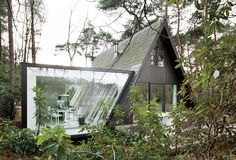 An A-Frame home gets a modern addition to house an office. Compliments it nicely.