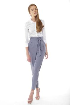 Our Charlotte High-Waist Tie Suit Trouser features a loose fitting design, high waist tie belt that is included and a straight leg cut. Its skinny leg silhouette makes it perfect for both corporate and casual looks. Pair with the Charlotte Cape Blazer for a complete look.