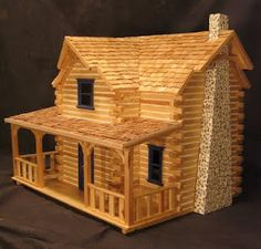 Log Dollhouse. 'It did not come with shingle so I split a bunch out of cedar.'
