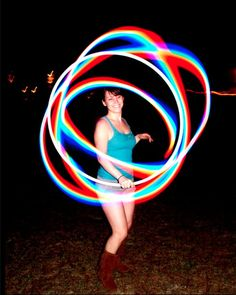 Love the colors! Thinking it must be a fiber optic hoop. They're so vibrant!
