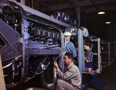 """October 1942. Inglewood, California. """"Employees at North American Aviation, Incorporated, assembling the cowling on Allison motors for the P-51 'Mustang' fighter planes."""" 4x5 inch Kodachrome transparency by Alfred Palmer for the Office of War Information."""