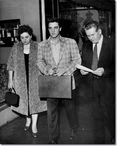 Flanked by his parents, Gladys & Vernon, Elvis Presley reported for Army duty - March 24, 1958
