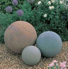 granite garden balls...can probably be made with hypertufa or concrete with color added in the mix.