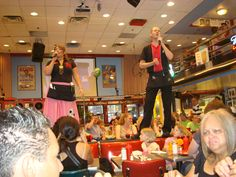 Ellen's Stardust Cafe in Times Square...the waiters randomly jump up on the tables and sing to you, mostly Broadway tunes, and they are GOOD.!  Such fun!