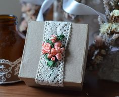 Silk ribbon embroidered coral roses on lace. http://caffeinatedkitten.wix.com/crafts