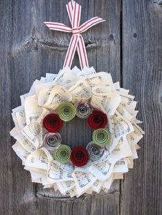 Beautiful musical sheet inspired Christmas wreath. The wreath is composed of musical sheets and colored paper designed to look like a rose. It looks simple and yet is very meaningful.