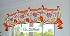 Pretty draped valance with graduated height and contrast cuffs, trim and handpainted finials.  www.skdesignscustom.blogspot.com