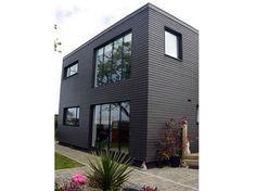black windows, black weatherboard, no architraves.