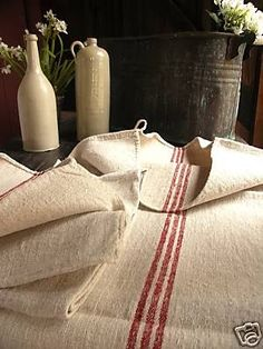What is our obsession (or is just me?) with antique grain sacks. We are starting to see them everywhere -  Ebay Maybe its because they are s...