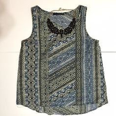 Patterned Sleeveless Blouse Patterned sleeveless blouse. Great condition. Does not include necklace. This top fits a size small. Tops Blouses