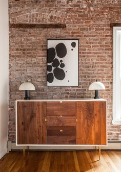 Organic Modernism buffet with brass accents, vintage mushroom lamps (Brooklyn Auction Barn), custom artwork