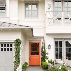 White Home with Orange Front Door