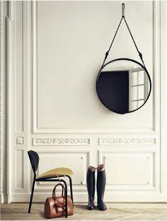a circular entryway mirror