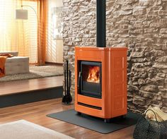 E904 S Stove with hand-made majolica cladding featuring such clear-cut lines that blends easily into any decor.
