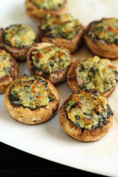 Spinach & Artichoke Stuffed Mushrooms - an incredibly easy party food that uses a little help from the grocery store ;) | foxeslovelemons.com