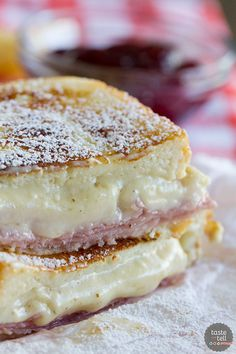 A mash up of 2 favorite sandwiches - a ham and cheese sandwich is slathered with a béchamel sauce, then battered and cooked in a skillet Monte Cristo style. Top with powdered sugar and raspberry jam if desired!