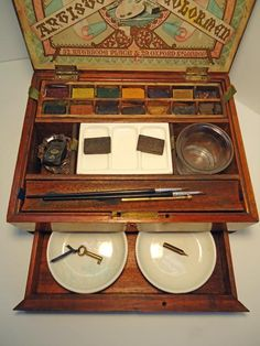 Antique watercolor paint box... I'd love to get this for Sheryl.