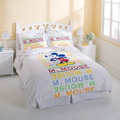 Mickey Mouse bedding. Love the rainbow colors.