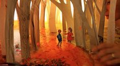 Storybook illustrations created with back-lit paper dioramas by Elly MacKay.