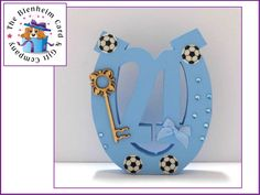 21 horseshoe in pale blue.  Football themed.  5 inches tall. 4 inches wide.  £9.50 plus postage.