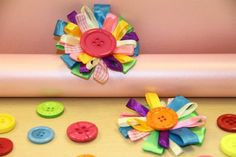 As it gets closer to winter and the days become a little dreary, there's nothing better than brightly coloured craftiness to help cheer up the grey. With this in mind, today we created this cute ribbon loop corsage which is perfect for adding to a coat, bag, or even sticking to a headband. Read on to find out how we made it.