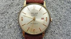 Helsa Vintage mans Watch  Aged silver dial with golden markers and Hands  Dimensions 38/40/12  Chrystal yes NEW Second hand yes, central  Date window at