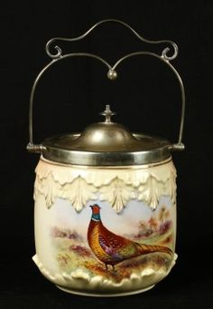 975: Locke & Co. biscuit jar with plated shaped handle : Lot 975