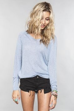 Corinne sweater-love both the sweater and ripped jean shorts.