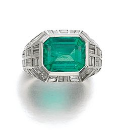 EMERALD AND DIAMOND RING, BULGARI Claw-set with a step-cut emerald, framed with baguette diamonds, size 51, signed Bulgari, Italian assay and maker's marks.