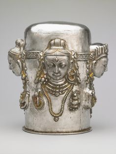 Four-faced Linga.     19th century. Nepal. Silver, repoussé     (via Rubin Museum of Art)  Silver Mukha Linga.  Sometimes used as covers or masks placed on the stone Shiva-Lingas in Temples