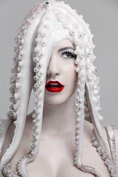 by Andrea Jezikova [red lips] [white octopus on head]