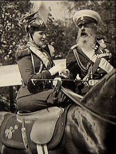 A very rare photograph of Alexandra Feodorovna on horseback, in a review of the Uhlan regiment that she was the colonel-in-chief of. She is with Grand Duke Michael Nicholaievich.